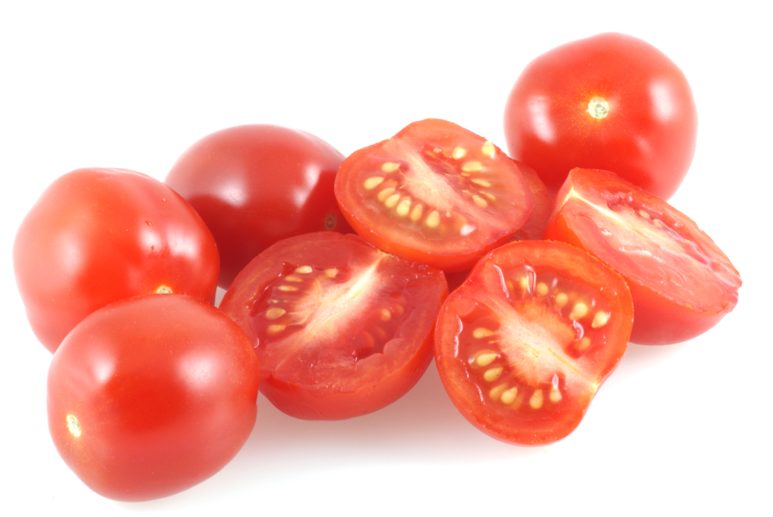Cherrytomatoes isolated on white and few of them are cut in half.